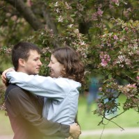 Embracing by a Cherry Blossom
